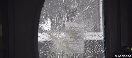 An explosion damaged glass at the entryway to the Jewish community center in Malmo, Sweden. (Photo: Patrick Persson/Sydsvenskan)