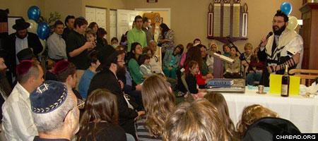 Rabbi Yossi Grossbaum speaks at a gathering at the Chabad-Lubavitch Jewish Community Center of Folsom, Calif.