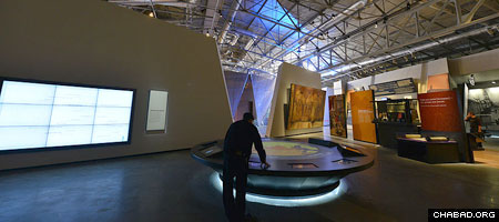 A visitor explores one of the interactive exhibits at the new Jewish Museum and Tolerance Center in Moscow.