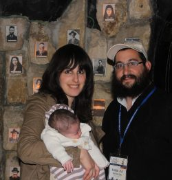 Mina and Avi Richler at a memorial for the Hebron Massacre victims, including her great-grandfather.