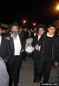 Mourners gather at the funeral of Rabbi Aharon Smadja.