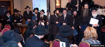 Fourteen community members were presented with their rabbinic ordination certificates.
