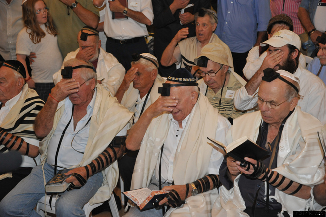 Holocaust survivors celebrated their Bar Mitzvah with new pairs of Tefillin that they placed on hand and head. They then covered their eyes when reciting the Shema.
