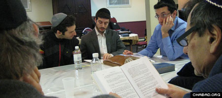 Studying the Tanya, the foundational work of Chabad philosophy, at Chabad of Queen Mary, Montreal, Canada.