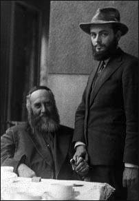 Her father, the sixth Chabad rebbe, Rabbi Yosef Yitzchak Schneersohn (sitting), with her future husband, Rabbi Menachem Mendel Schneerson