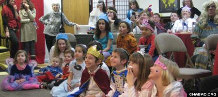Children in Flagstaff, Ariz., delight to Purim entertainment.