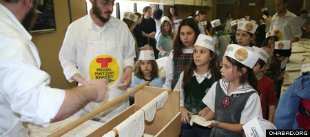 In Toronto, more than 3,000 children come annually to the Chabad Lubavitch Community Centre to make matzah in a fully outfitted model bakery that includes an authentic oven