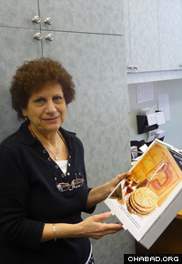 Roz Harroche, of Pierrefonds, Quebec, Canada, with box of shmurah matzah.