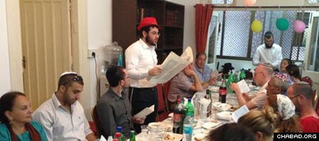 Rabbi Israel Kozlovsky reading the megillah on Purim. He says that at the top of his list is to have the Nariman House—where Rabbi Gavriel and Rivkah Holtzberg were murdered with four other Jews in their Chabad House in 2008—up and running.