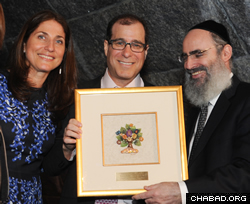 Marc and Esther Sholes received community service awards. Sholes recalled how his children went to Chabad's camp and preschool, with one of them volunteering with the Friendship Circle, a special-needs buddy program.