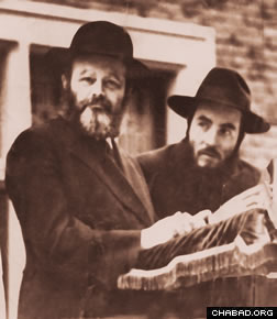 Rabbi Goldstein with the Lubavitcher Rebbe at a Lag BaOmer day parade in the 1950s.