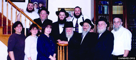Rabbi Yosef (''Uncle Yossi'') Goldstein (center) with his family.