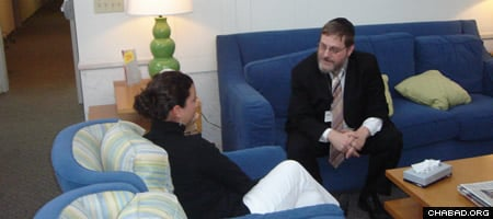 Rabbi Yosef Lipsker confers with a counselor at Caron Treatment Center in Wernersville, Pa