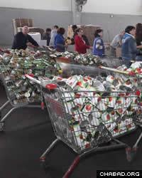 Between 7,000 and 8,000 needy families are referred to Colel Chabad for Passover goods via Israel's social service agencies