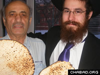 Rabbi Avrohom Simmonds delivered matzahs to Anosh Rahimzadeh and other local residents before Passover.
