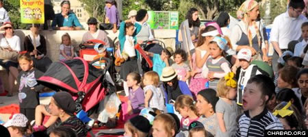 Parents and children gathered in Jerusalem for Lag BaOmer parade and events organized by Chabad of Rechavia.