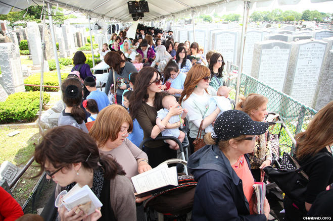 More than 50,000 people from around the world gathered Tuesday, June 11 corresponding to the third day of the Hebrew month of Tammuz, at the Old Montefiore Cemetery in Queens, N.Y. to commemorate the 19th anniversary of the passing of the Rebbe, Rabbi Menachem M. Schneerson, of righteous memory. (Photo: Bentzi Sasson)