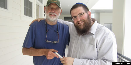 Rabbi Chaim Bruk, right, and Mike Chaet of Bozeman with his new mezuzah