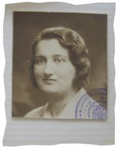 My grandmother's passport picture. You can see the Nazi seal in the corner.