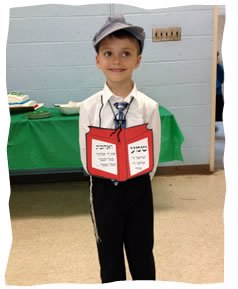 Elishama all dressed up for his siddur party