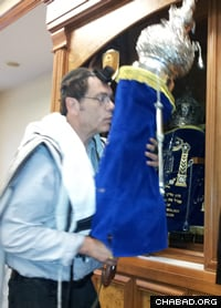 Returning the new Torah scroll to the ark following its first reading in the Skokie synagogue on Aug. 12.