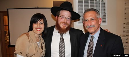 Rabbi Bentzy and Chani Shemtov with Lon S. Kaufman, vice chancellor for academic affairs and provost at UIC.