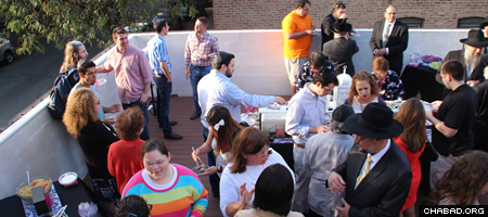 The reception was held on the new center's rooftop, which will again be used for the communal Sukkah.