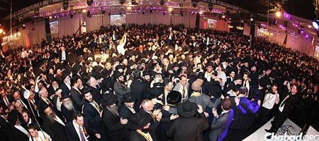 Emissaries and guests dance together at a previous gathering. (file photo)