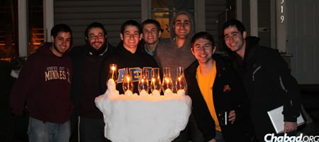 Rabbi Yitzi Steiner, second from left, who co-directs Chabad at the University of Minnesota, with AEPi fraternity members at last year's menorah lighting.