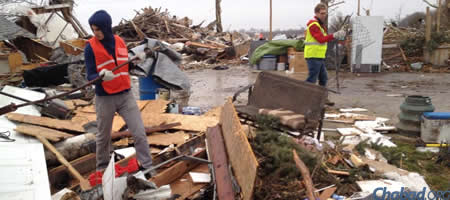 Students Yosef Peysin and Raphael Stern assist with the cleanup in Gifford, Ill.