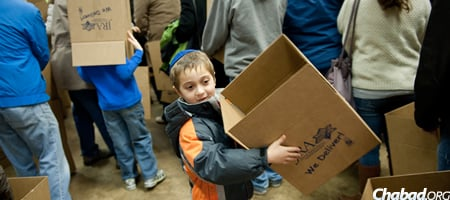 All ages groups lend a hand, including little Eitan Cassway.