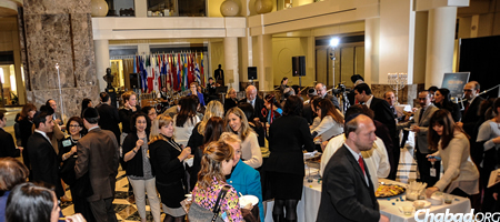 "Guests mingle at ""A World of Light"" Chanukah event for the Washington, D.C., international community. (Photo: Len De Pas)"