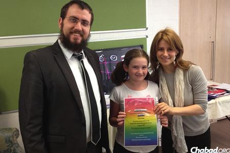 Rabbi Shmuel and Chasia Feldman, co-directors of Chabad ACT (Australian Capital Territory), with an award-winning student.