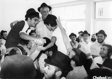 Ariel Sharon dances with his sons Omri, left, and Gilad, at Omri's bar mitzvah in Kfar Chabad.