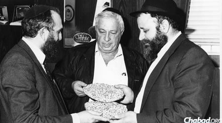 Receiving hand made shmurah matzah from Chabad activists before Passover.