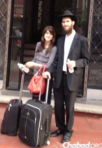 Rabbi Yoel and Rivky Wolf on the way to their new home in Chicago.