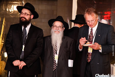 Rabbi Mendel Kaplan, left, and Rabbi Zalman A. Grossbaum, center, both of Thornhill, Ontario, addressed the gathering.
