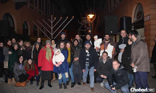 Rabbi Shmuel Faigen, back row with baby, has been living in Hungary since 2010 with his wife, Riki, as co-directors of Chabad on Campus of Debrecen.