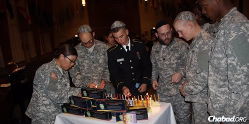 Rabbi Mendy Stern, center right, was once denied a commission in the U.S. Army Chaplaincy Corps because of his beard. He is now a captain on active duty, stationed at Fort Leonard Wood in Missouri.