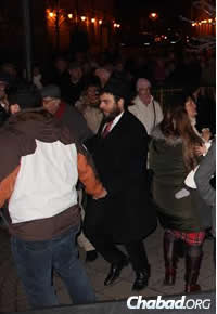 Rabbi Faigen, dancing with young and old on Chanukah.