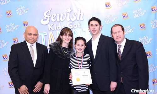"""Dante Cabactulan, left, son of Libran N. Cabactulan, ambassador to the United Nations from the Philippines, came to see the """"Jewish Kids Got Talent"""" competition, and met Estee and her parents, Chanie and Glenn Ackerman, and her older brother and table-tennis mentor, Akiva."""