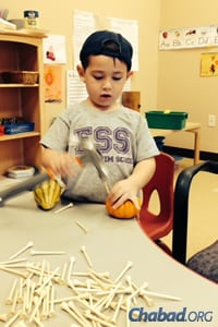 For preschool students at Gan Menachem in Dallas, doing is a major component of learning.