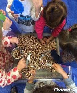 Guided group activities at Gan Menachem promote social skills.