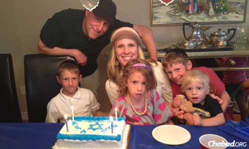Jason and Allison Meshwork say their whole family changed for the better after their oldest son, Levi, center right, attended a Chabad preschool in Toronto, Canada.