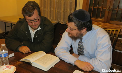 Ryan Hertz, left, has been studying Tanya with Rabbi Pinson for about a year-and-a-half.