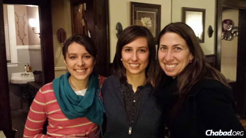 From left: Alyssa Goch, Cara Goch and Stephanie Reich at Chabad's Open House on Tu B'Shevat, which drew more than 100 people despite a sudden snowstorm.