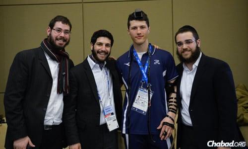 From left: Rabbi Dovid Katz, Rabbi JJ Hecht and Rabbi Chaim Landa with Israeli alpine skiier Virgile Vandeput.