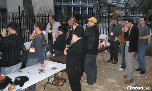 #openShabbat is an unplugged meal and networking event—scheduled for March 7 at the Hilton Austin Hotel—for Jewish guests of SXSW and local Jewish residents. Attendees at a previous year's event gather above for a kosher barbecue.