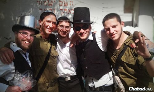 Mordy Botnick, left, and friends from Chayal el Chayal will again bring Purim cheer from around the world to lone soldiers in the IDF.