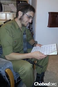 Lone soldier reads a note from abroad.